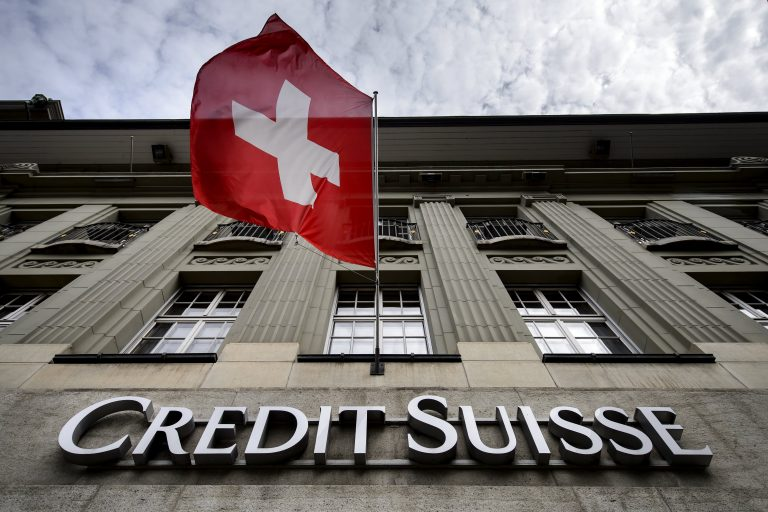 Credit Suisse cuts dividend on hit from hedge fund scandal; investment bank head and chief risk officer step down